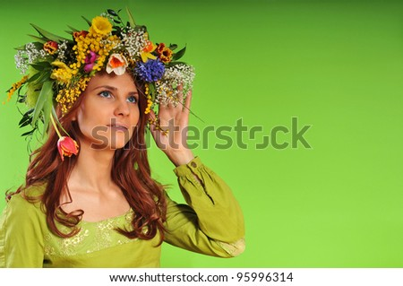 Spring-woman in wreath of flowers - stock photo