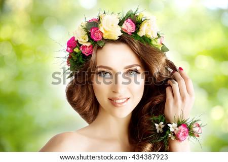 Spring woman Young  Girl flowers Beautiful model wreath bracelet Bride bridesmaid makeup spa Lady make up Mascara lashes lipstick lips eye shadow shiny hair manicure nail polish Products Treatment - stock photo