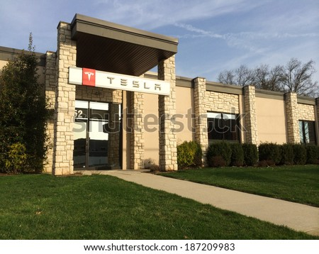 SPRINGFIELD, NJ - APRIL 14: An exterior view of a Tesla Service facility is shown on April 14, 2014 in Springfield, NJ. On March 11, 2014 New Jersey passed new rules banning direct-to-consumer sales. - stock photo