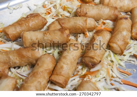 Springs rolls on a bed of cabbage on display at a chinese restaurant buffet - stock photo