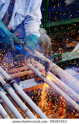 sprinkle sparks resulting from penetration works using oxygen and acetylene gas cutter - stock photo