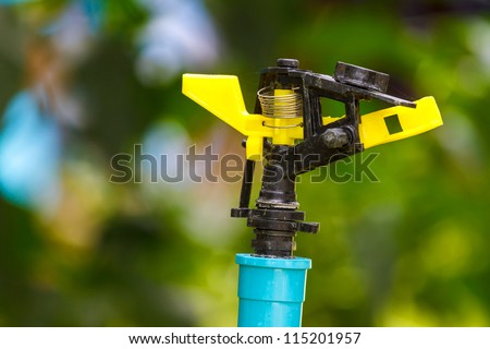 sprinkler of automatic watering in the garden - stock photo