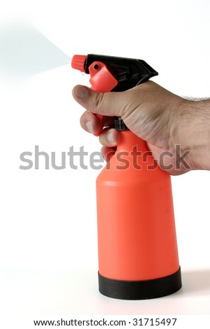 sprinkling water sprayer isolated in man hand - stock photo