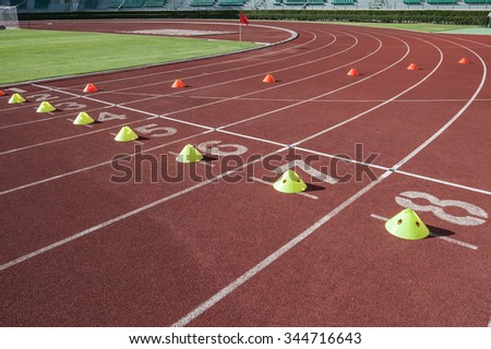 sprint start in track and lanes of running track, Red Asphalt for runners with number - stock photo