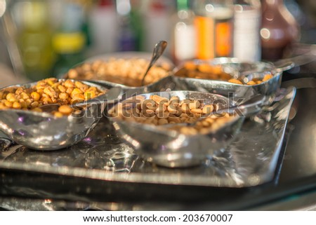 Spritz aperitif with mixed nuts and stuffed olives - stock photo