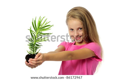sprout plant growing from little girl hands - stock photo