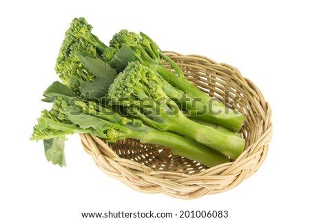 Sprouts baby broccoli on bamboo basket  isolated on white Background - stock photo