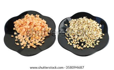 sprouts of lentil and buckwheat seeds on plates, on white isolated - stock photo