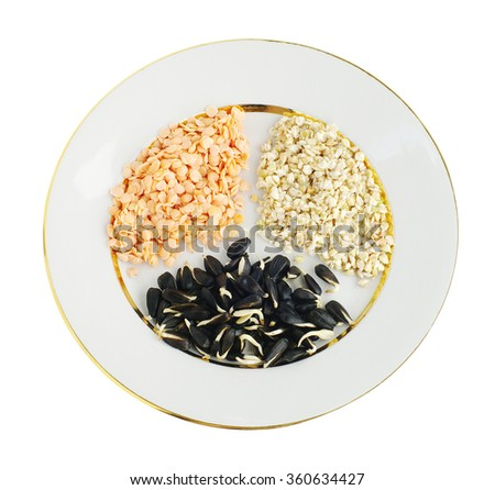 sprouts of lentil, buckwheat and sunflower seeds on plate, top view, on white isolated  - stock photo