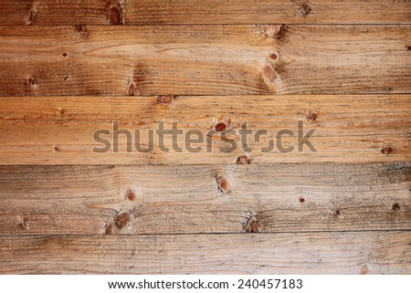 spruce boards real texture with many knots on exterior of a lodge - stock photo