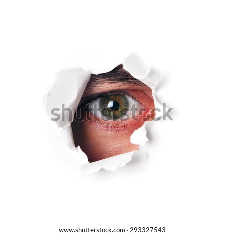 Spy eye watching through a hole isolated - stock photo