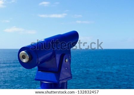 Spyglass is pointed towards the sky on the coast - stock photo