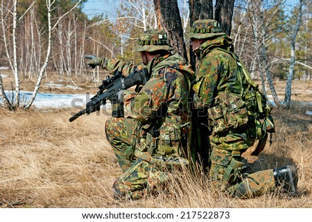 Squad of soldiers during the military operation - stock photo