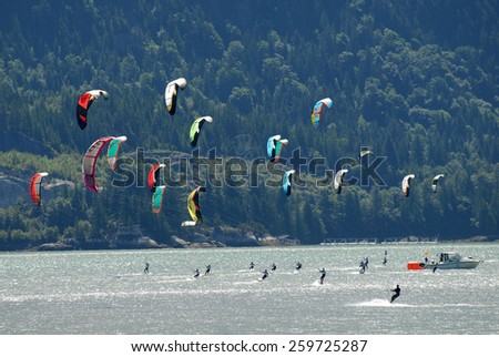 SQUAMISH, BC, CANADA - AUGUST 4, 2012: Athletes compete in the Kiteboarding Racing Championship in Squamish, BC, Canada, ON August 4, 2012. - stock photo