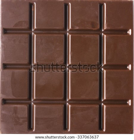 Square dark bitter chocolate bar isolated on white background. Top view point. - stock photo