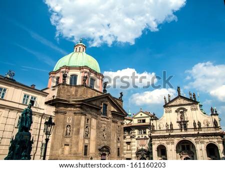 Square near Charles bridge in Prague, blue sky background - stock photo