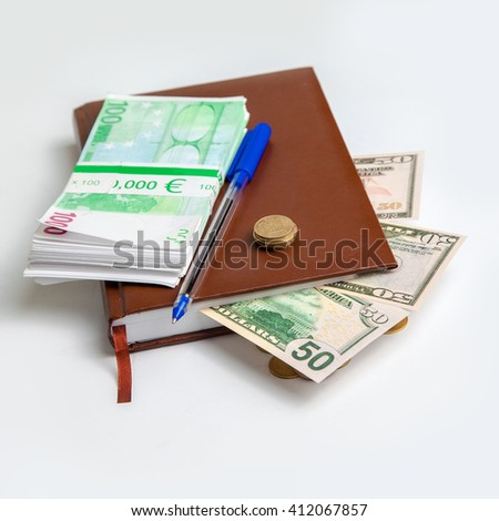 square photo of bundles of euro money and dollars in the ledger - stock photo