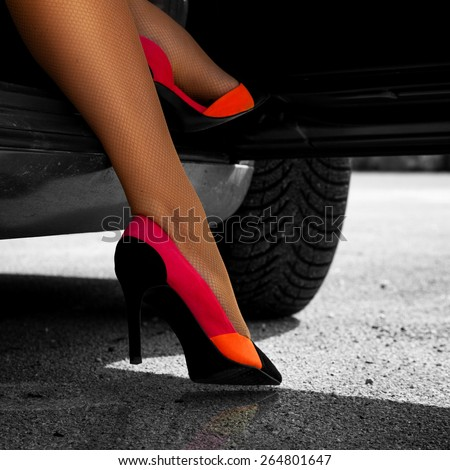 Square picture of sexual woman's feet in high heels outdoors - stock photo