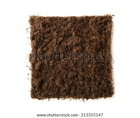 square piece of soil isolated on white - stock photo