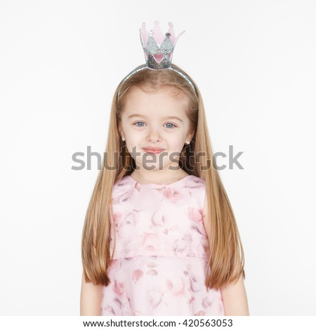 Square portrait of cute smiling little blond girl in princess dress wearing a crown isolated on white. Long hairstyle - stock photo