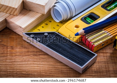 Square ruler pencil blueprints wooden meter and studs construction level on vintage wood board maintenance concept. - stock photo