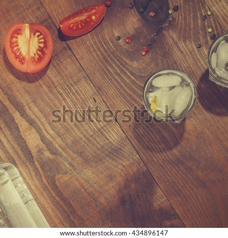 Square shot, top view, closeup. Vintage. Vodka, gin. tequila in a glass with ice on a wooden table, a reflection. top view, closeup - stock photo
