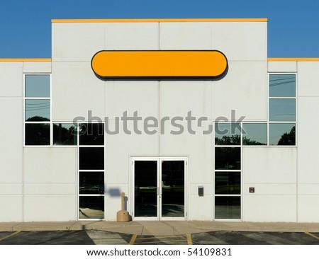 Square windows form pattern around building entrance - stock photo