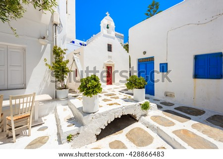 Square with church on whitewashed street with typical Greek architecture in beautiful Mykonos town, Cyclades islands, Greece - stock photo