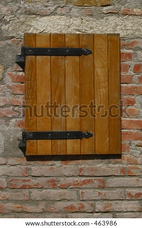 Square wooden shutter at a villa in Italy - stock photo