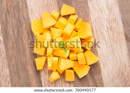Squash butternut slice on a wood background. - stock photo