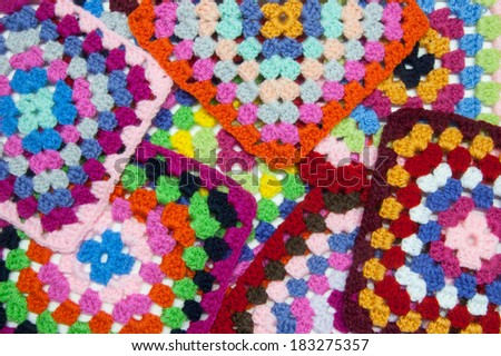 Squattered granny squares of crochet. Homemade. - stock photo