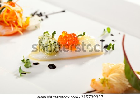Squid Canapes with Salmon Roe and Greens Sauce - stock photo