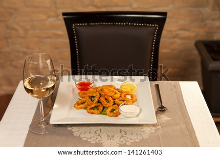 Squid with red and white sauce and white wine - stock photo