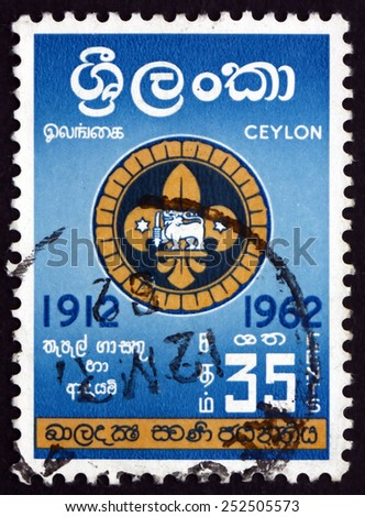 SRI LANKA - CIRCA 1962: a stamp printed in Sri Lanka shows Badge of Singhalese Scouts, Boy Scouts of Ceylon, 50th Anniversary, circa 1962 - stock photo