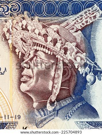 SRI LANKA - CIRCA 2005: Dancer with Local Headdress on 50 Rupees 2005 from Sri Lanka. - stock photo