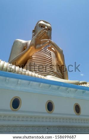 Sri Lanka. Statue of a seated Buddha. - stock photo