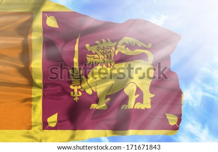 Sri Lanka waving flag against blue sky with sunrays - stock photo