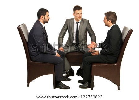 Srious conversation of three business men  sitting on chairs isolated on white background - stock photo