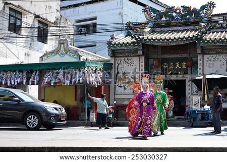 SRIRACHA, THAILAND -  FEBRUARY 5 : Chinese opera actors walking across the street to offering Shrine of the Black Sea on February 5, 2015 in  Sriracha, Chonburi, Thailand - stock photo