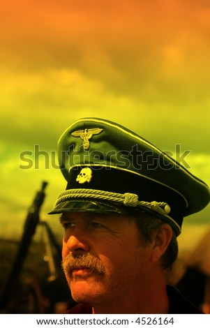 SS Officer Study at Sundown with Machinegun in Background with room above for Text - stock photo