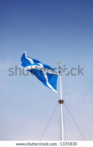 St Andrews cross - Scottish Flag - on flagpole with weather vane on top - stock photo