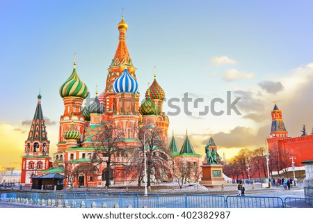 St. Basil's cathedral and the Kremlin on the Red Square in Moscow at sunset - stock photo