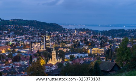 St. Gallen City, Beautiful Night Panorama Aerial View of St. Gallen Cityscape Skyline, Abbey Cathedral of Saint Gall, University of St.Gallen and Kirche St. Laurenzen at Dusk in Autumn, Switzerland - stock photo