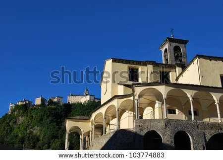 St. Gaudenzio church against blue sky, Sacred mountain sanctuary on background, Varallo Sesia village, Piedmont, Italy - stock photo