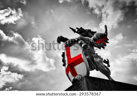St George dragon statue in London, the UK. Symbol of England. Black and white with red St. George's Cross - stock photo