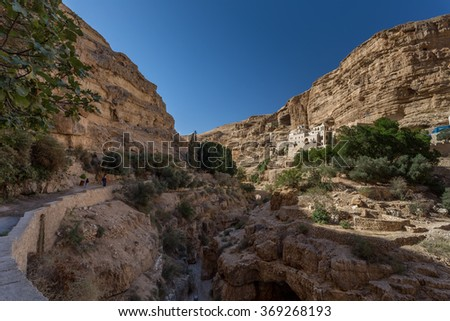 St. George Orthodox Monastery is located in Wadi Qelt. The sixth-century cliff-hanging complex, with its ancient chapel and gardens, is still inhabited. - stock photo