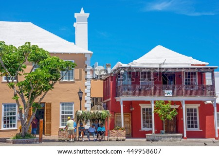 ST.GEORGEâ??S, BERMUDA, MAY 27 - Colorful buildings with white roofs to collect water on May 27 2016 in St. George?s Bermuda.  - stock photo