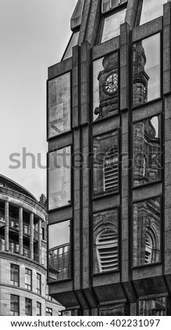 St. George's Tron Parish Church reflected onto the windows of a nearby office block in Glasgow, Scotland - stock photo
