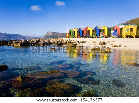 St James Beach with colourful bathing boxes, Cape Town, South Africa - stock photo