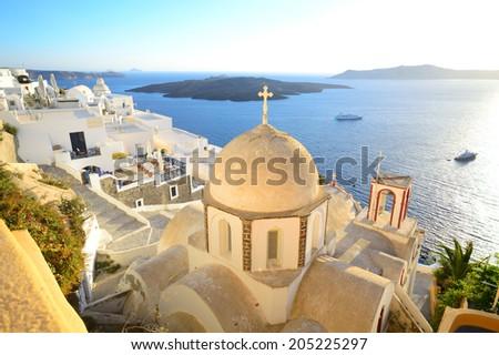 St. John The Baptist's church and the view above volcanic caldera in Fira, Santorini - Thira, Cyclades islands, Greece - stock photo